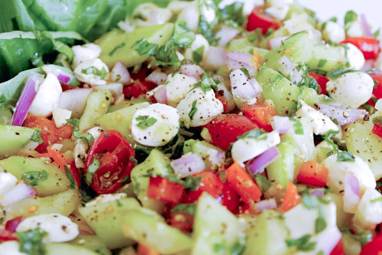 Caprese side salad using summer produce.