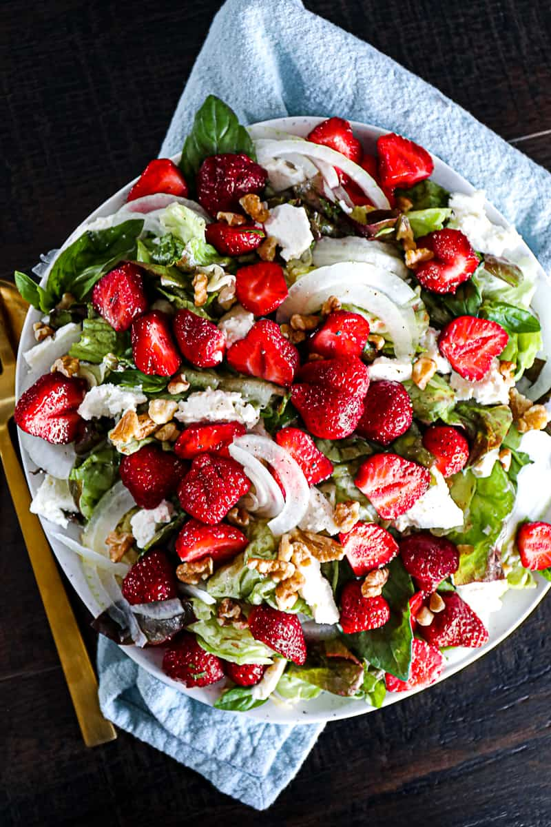 Cold summer salad with strawberries and onions.