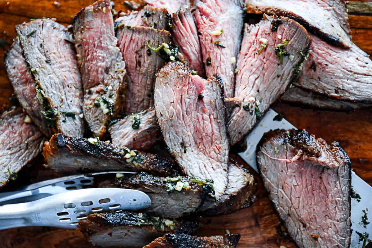 Cooked Tri Tip sliced thinly with tongs