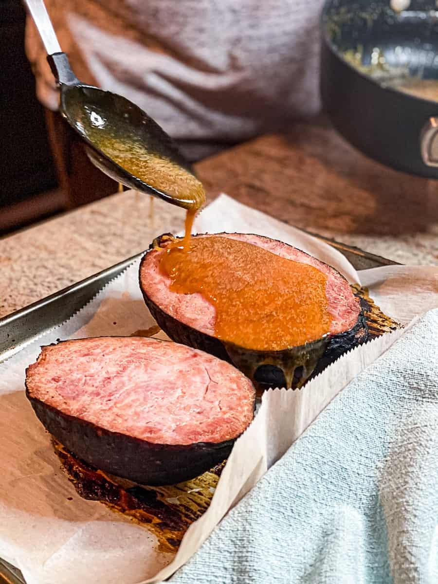 Drizzling homemade honey glaze on baked Ham Nugget