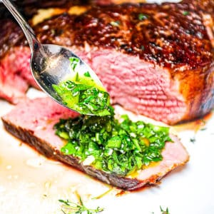Drizzling on Chimichurri Sauce For Steak.