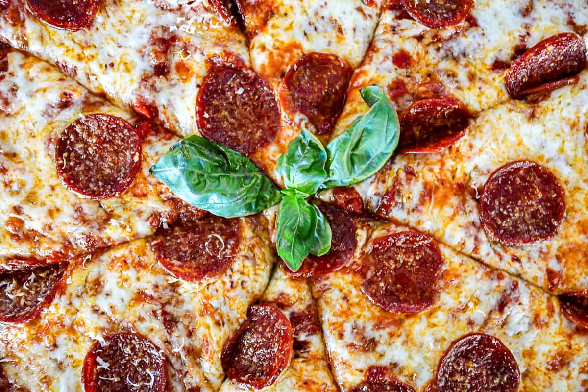 Pepperoni Pizza with fresh basil and parmesan cheese