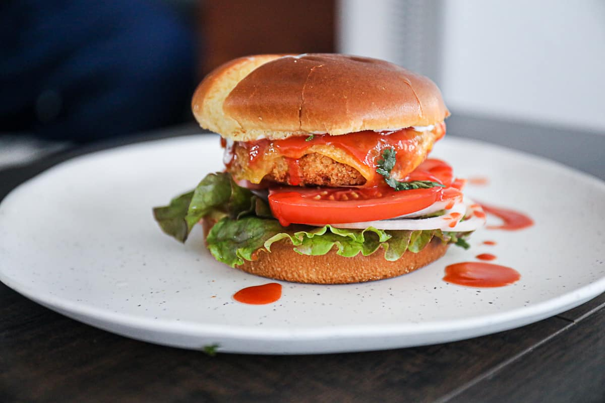 Air fried frozen chicken patty sandwich with buffalo sauce and blue cheese