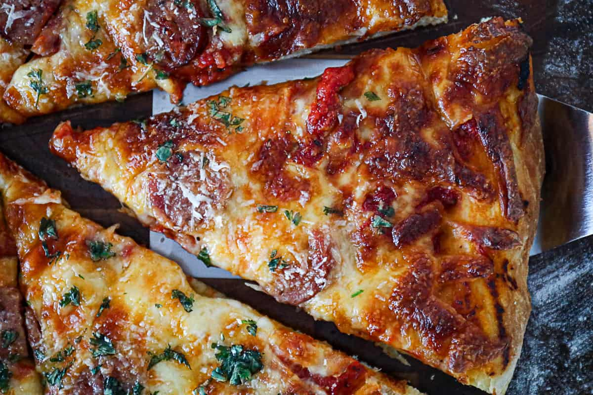 Closeup shot of smoked pizza with cheese and meat