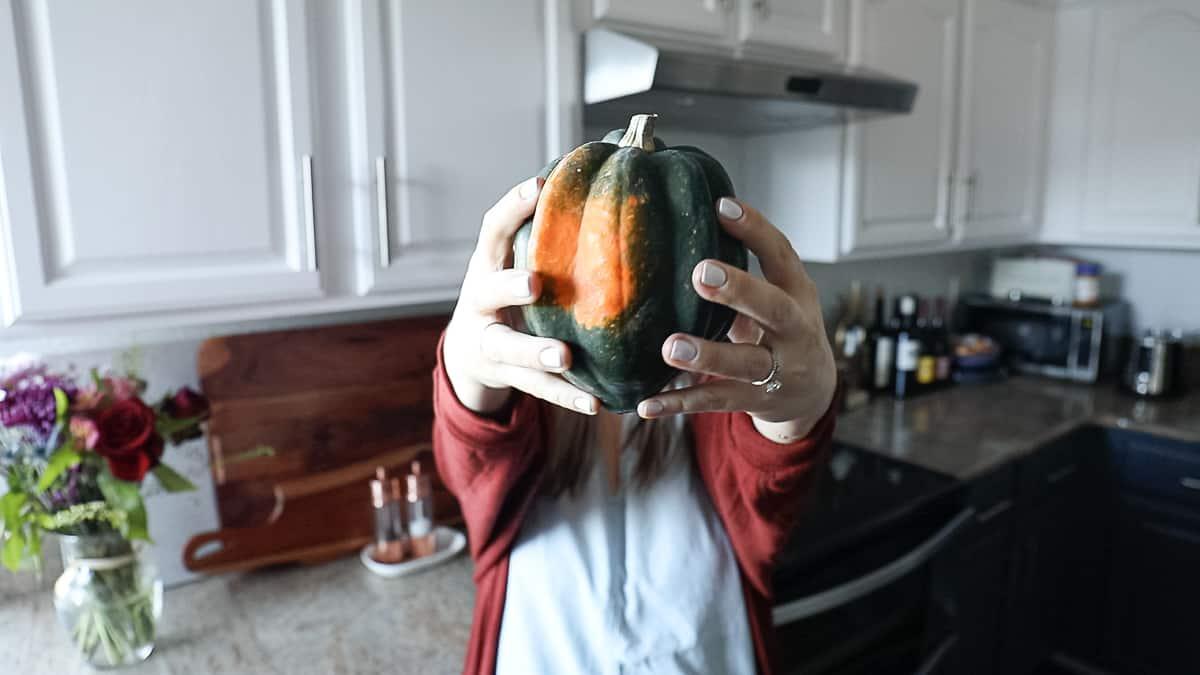 holding fall seasonal vegetables acorn squash