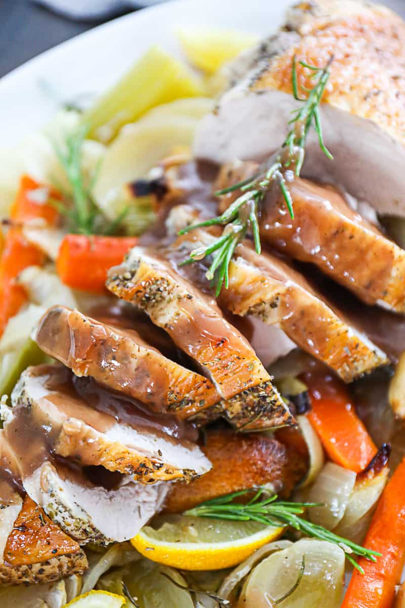 Roasted Turkey Breast With herbs vegetables and gravy