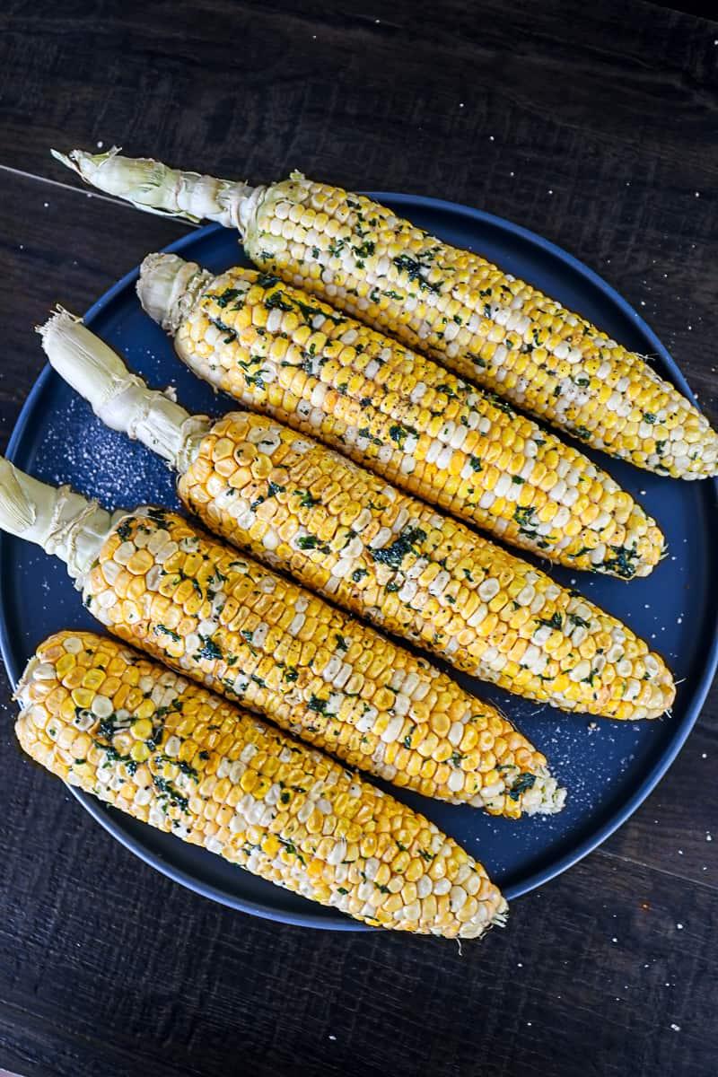 Smoked Corn On The Cob Recipe with husk stalks