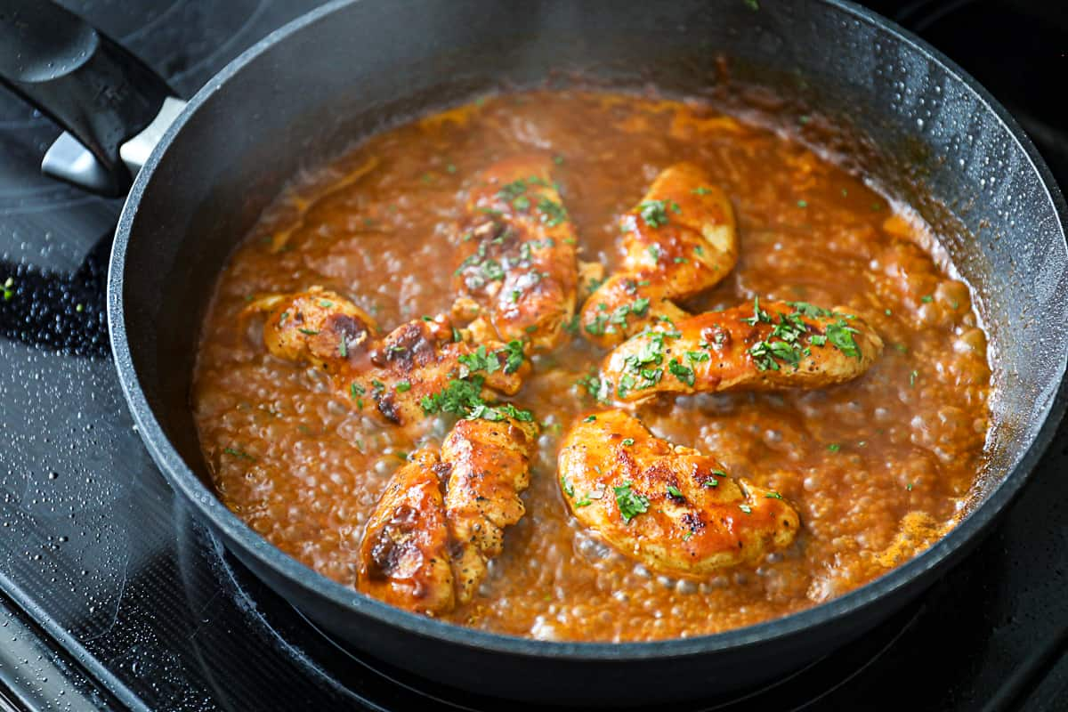 Simmering Chicken Breast in Enchilada Sauce